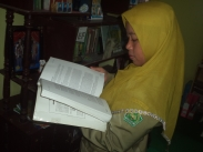 Bu Anis reading through the ETS TOEFL book.