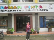 Wilda in front of Rumah Pintar at Universitas Brawijaya.